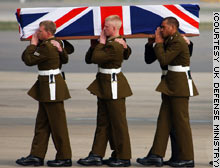 A coffin draped in the British flag is carried from a military cargo plane at Brize Norton Royal Air Force Base in England on Saturday.