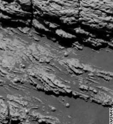 Scientists say sediments laid down by flowing water are seen in this image of the Mars rock named
