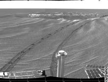 Scientists are busy analyzing Opportunity's new view of the plains of Meridiani Planum.