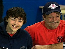 Shawn Hornbeck, 15, smiles next to his stepfather, Craig Akers, after four-year-long abduction