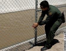 story.immigration.fence.gi.jpg